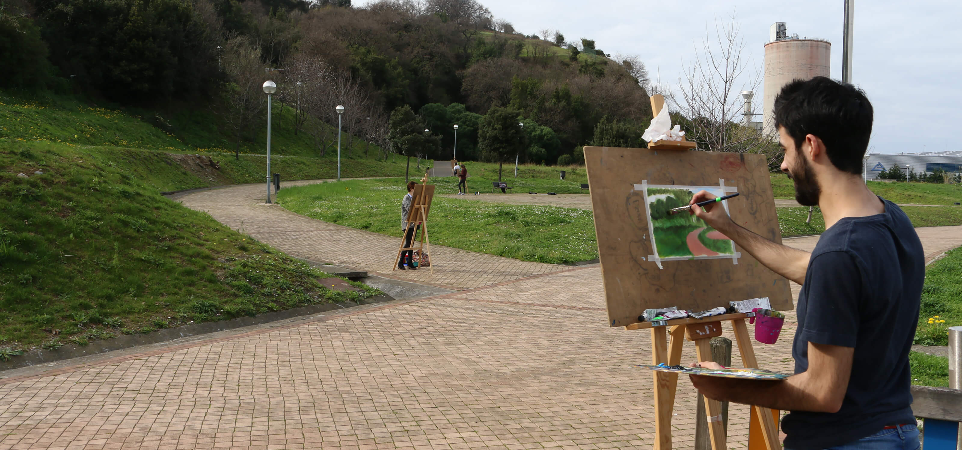 DigiPen Europe-Bilbao students painting at easels in a park