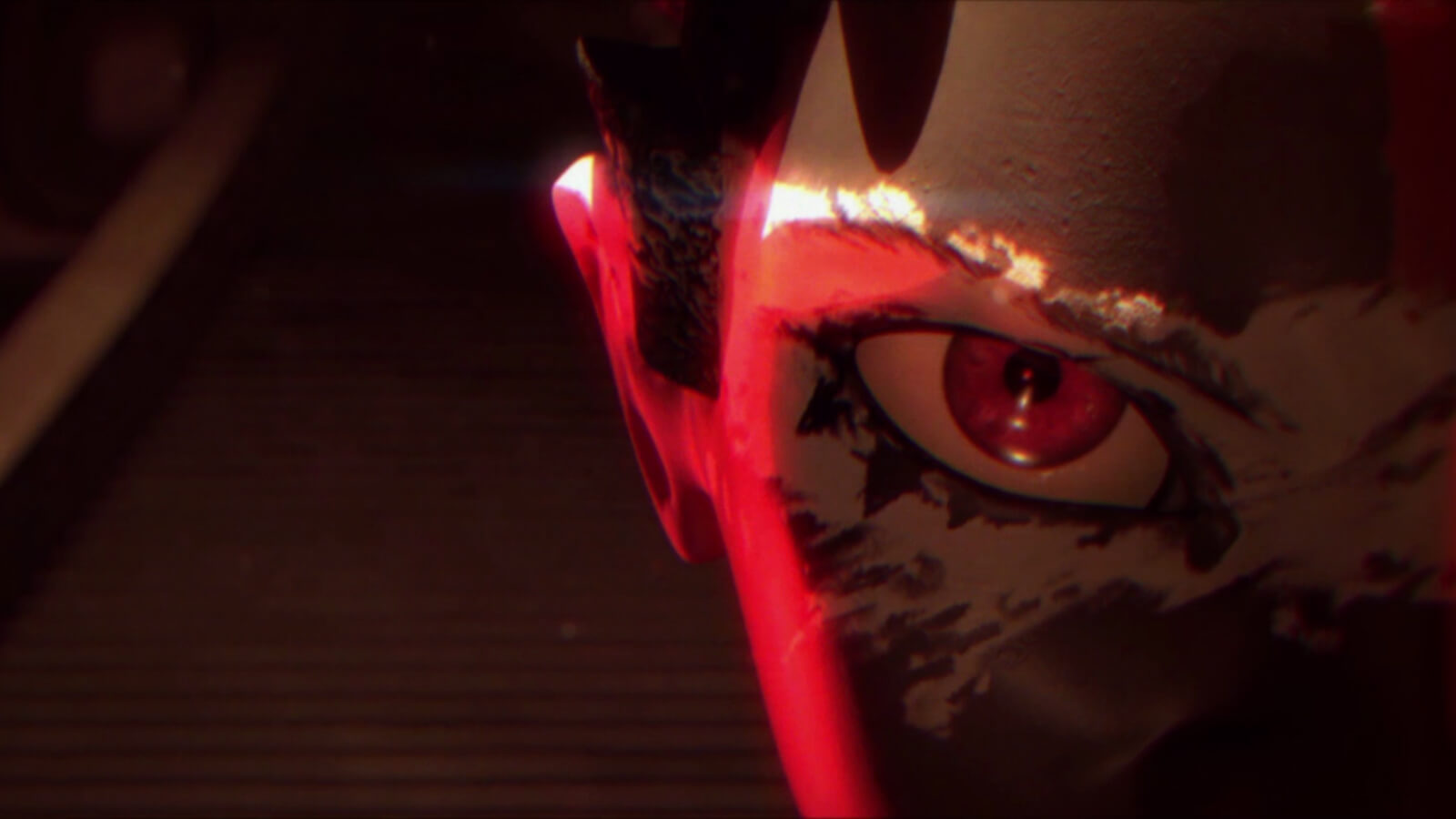 Extreme close up of a face on the right half of the image, including an eye and ear lit by red light
