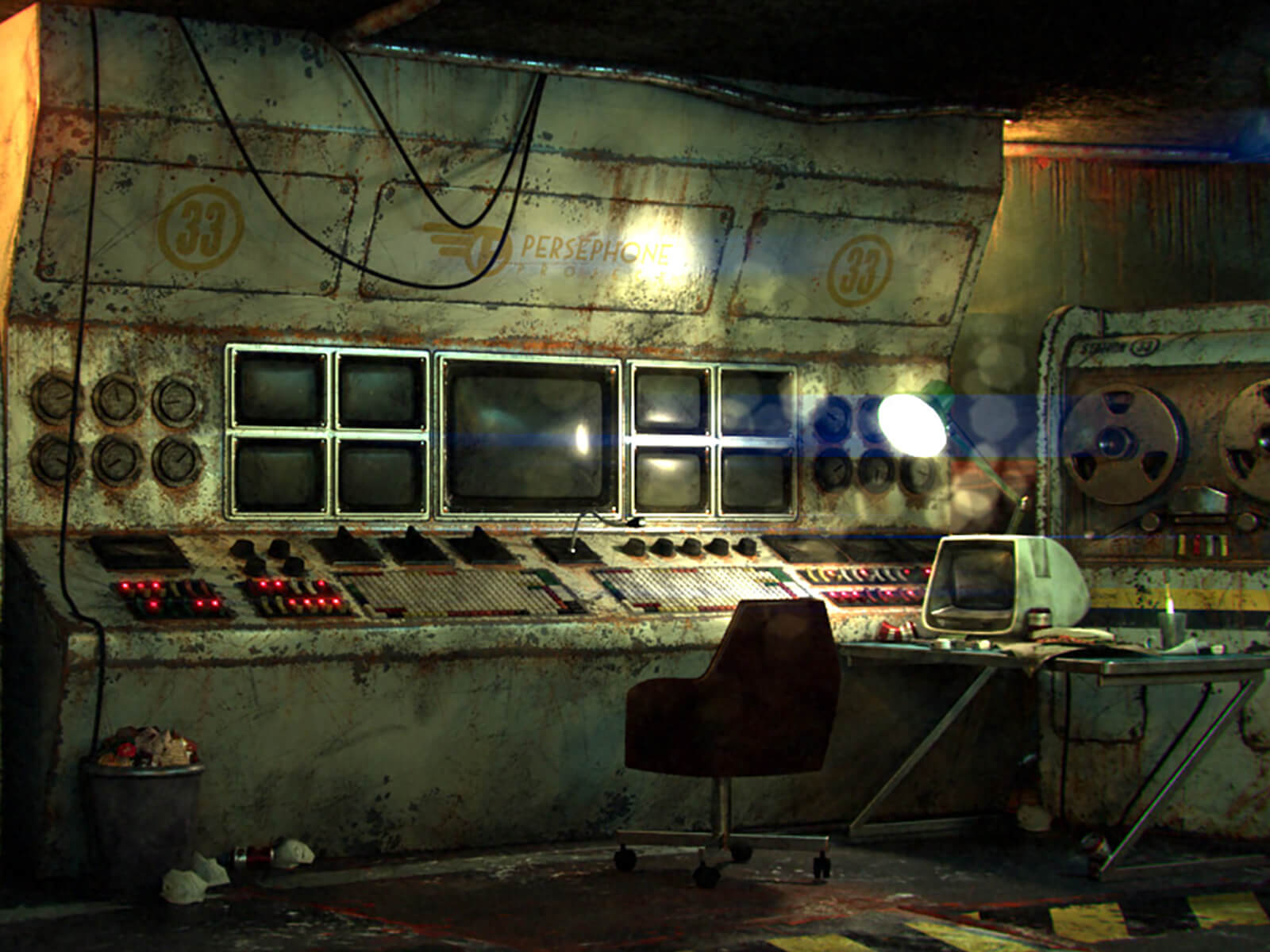 In an underground bunker, a dilapidated control console of obsolete electronics, monitors, and magnetic tape computers.