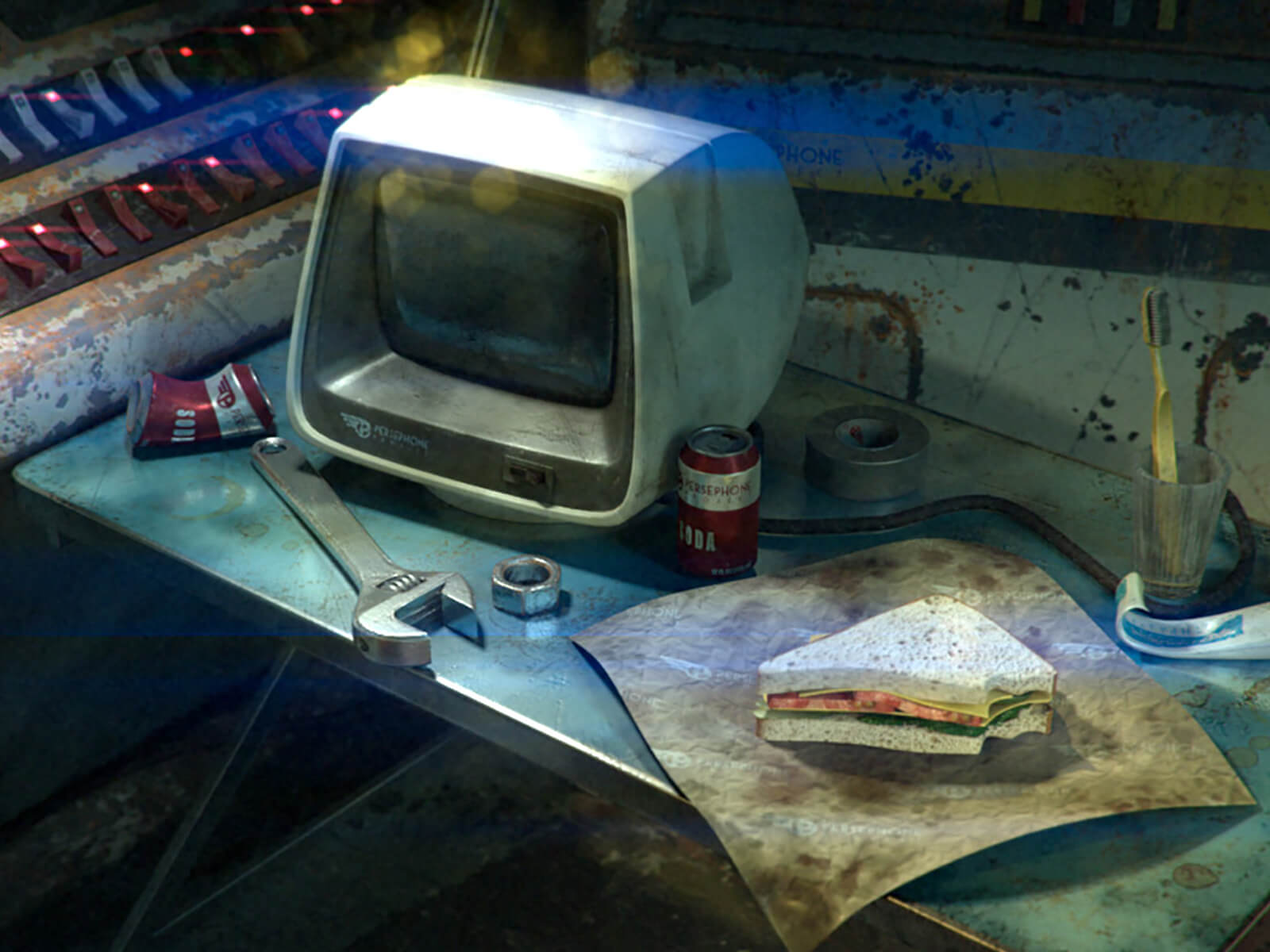 An antiquated computer monitor sits on a messy blue fold-out table with a wrench, toothbrush, and half-eaten sandwich.