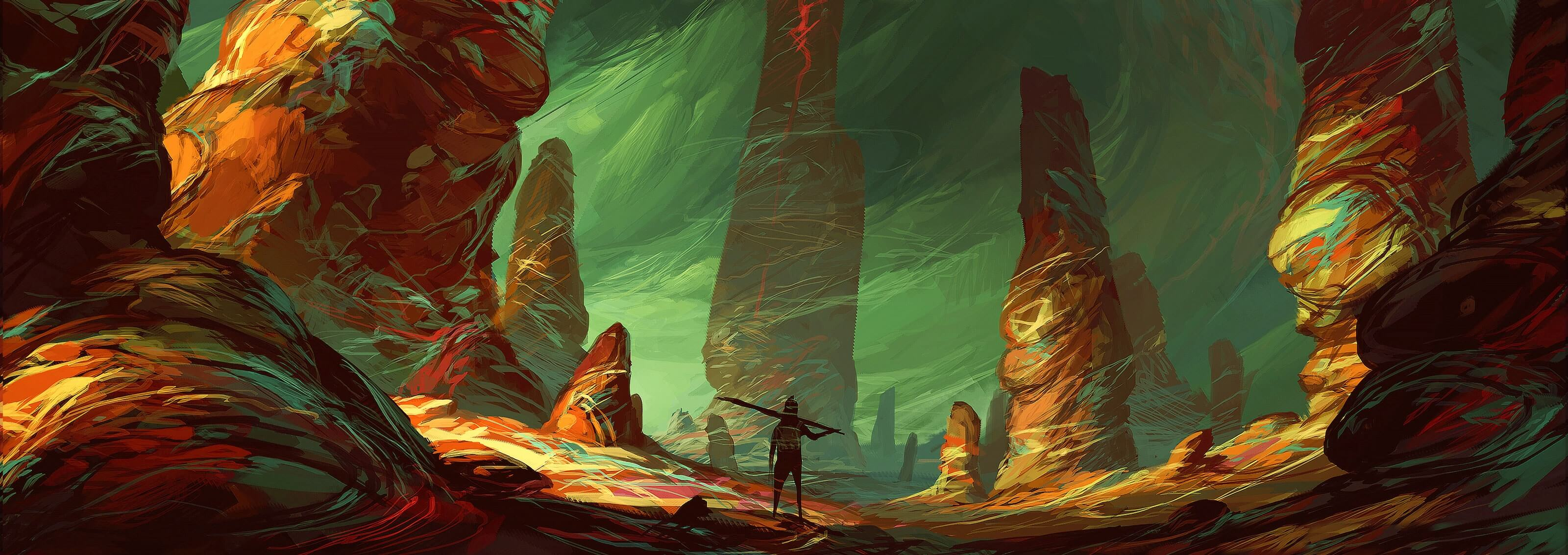 A rocky, alien environment with colorful outcroppings dwarf a humanoid figure standing with its back turned in the foreground