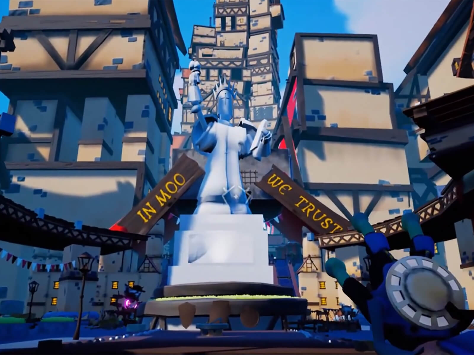 "Game screenshot: Large marble statue stands in a medieval town plaza. A sign reads: ""In Moo We Trust"""