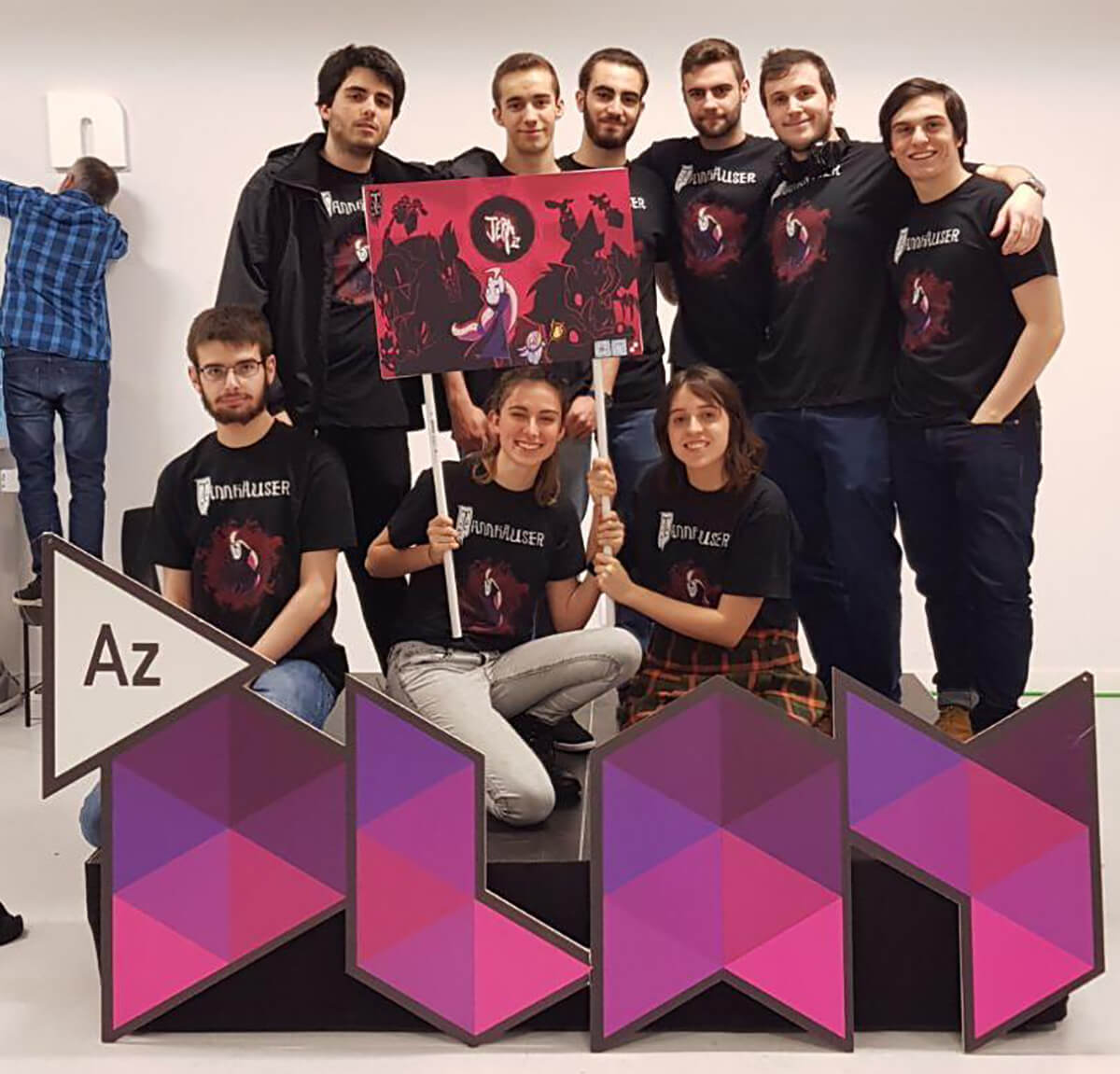 Picture of Team Tannhauser holding a Jera flag in front of an AzPlay sign